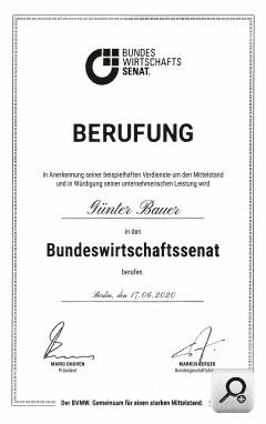 image_manager__lll_textbild_240_lupe_urkunde_berufung_in_den_bundeswirtschaftssenat